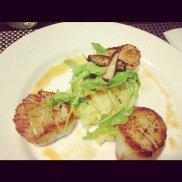 Seared scallops with rosemary polenta, arugula and beurre blanc