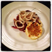 Grilled calamari with charred red onion, fennel and grilled lemon
