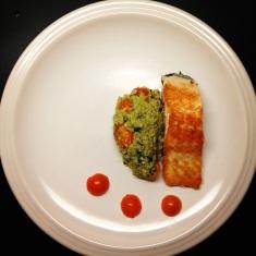 Seared salmon with pesto quinoa and cherry tomatoes