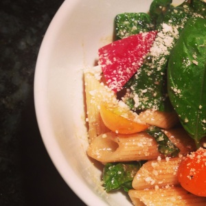 Pasta salad with fresh tomatoes, peppers and greens, tossed with balsamic vinaigrette and basil